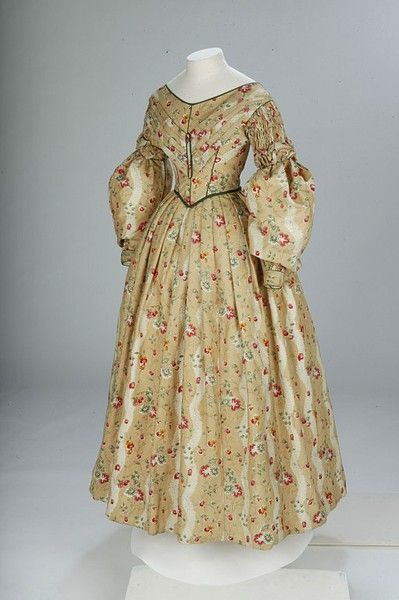 Dress  Place of origin:  Great Britain (made)    Date:  1836-1840 (made)    Artist/Maker:  Unknown (production)    Materials and Techniques:  Printed cotton edged with silk satin piping and lined with linen and cotton    Credit Line:  Given by Miss G.E. Hill    Museum number:  T.32-1940