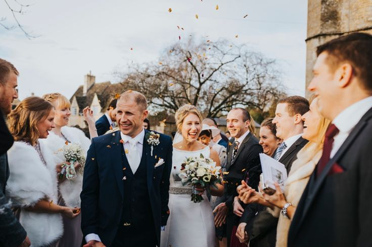 Confetti photos can always bring out the fun and the giggles in everyone. Photo by Benjamin Stuart Photography #weddingphotography #confetti #groupphoto #weddingday #justmarried #churchwedding