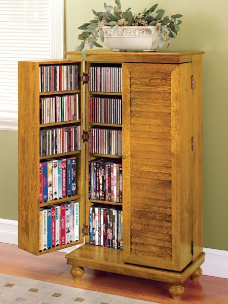 Compact cabinet stores over 600 CDs! This attractive Mission-style cabinet fits in a small space, yet offers storage for 612 CDs, 298 DVDs or 172 VHS tapes! Solid oak, it fits in a space less than 24