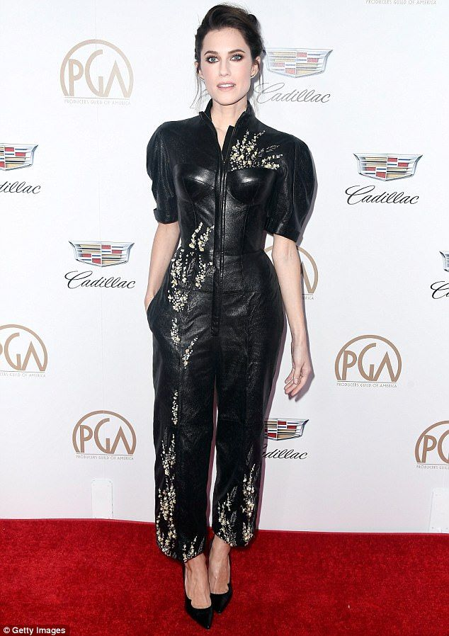 In stitches: The daughter of legendary news anchor Brian Williams looked chic in the structured jumpsuit that featured golden embroidery up and down the body