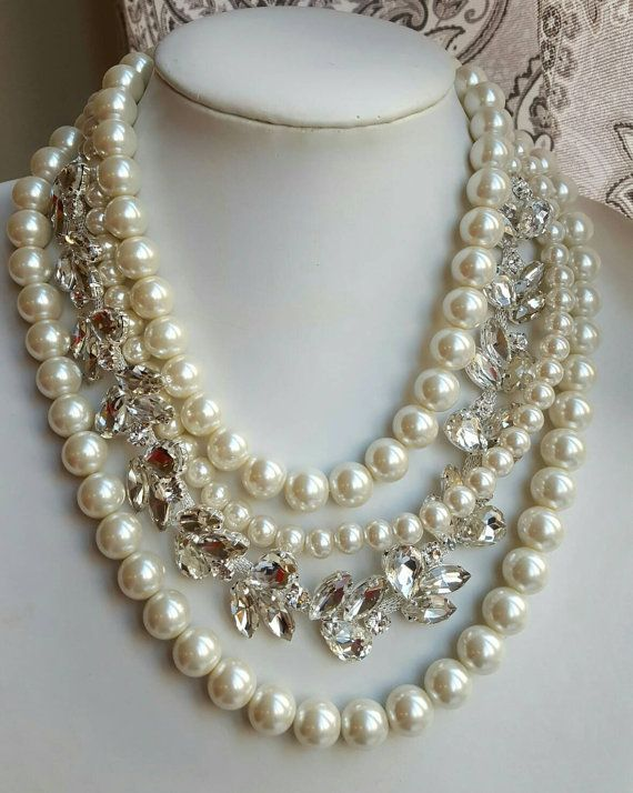 Check out this item in my Etsy shop https://www.etsy.com/ca/listing/476029604/chunky-multistrand-pearl-rhinestone