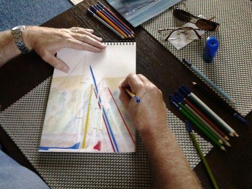 My husband creating art whilst on holiday at Neyland Marina 2013.