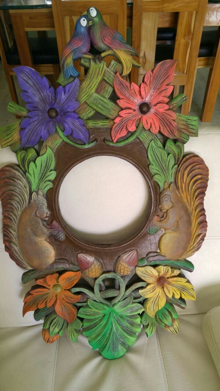 Espejo en madera tallada