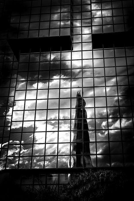 Love black and white pictures with strong contrasts.  I took this picture of the shard reflected in another building in London.