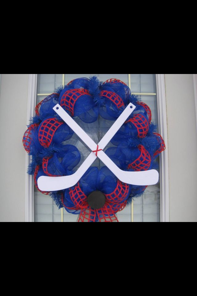 Hockey wreath. Might make this with real knee hockey sticks, hockey socks and skate laces?
