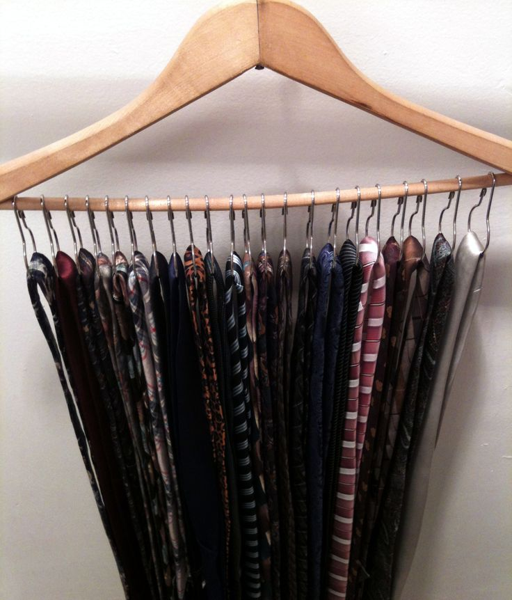 Saw this idea for scarves and belts but really, it's PERFECT for mens ties. Used metal shower hooks on a hanger and looped the ties on.