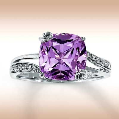 Beautiful engagement ring! Purple is my favorite color :)