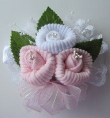 Corsages for a baby shower made out of baby socks! #toocute #socks