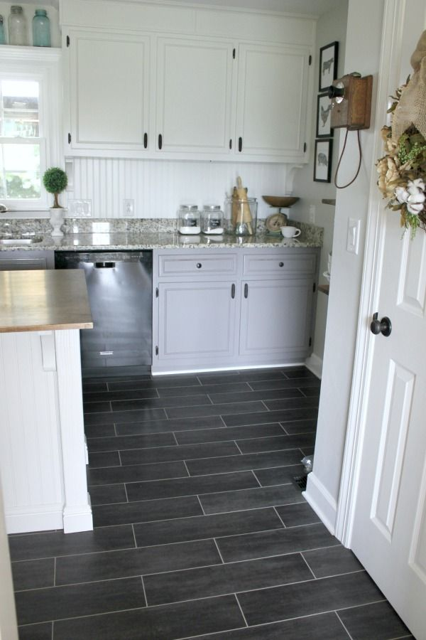 Vinyl flooring in the kitchen hgtv pertaining to white for Best vinyl flooring for kitchens