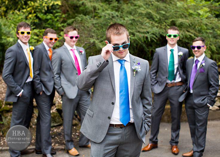 rainbow groomsmen (: coloured ties and sunglasses. Nice, I wont be doing the sunglass thing lol