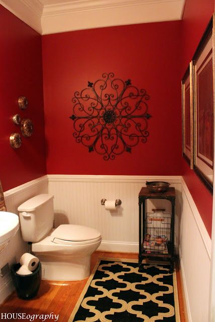 Love the rug with the red walls and black iron wall decor but for my dining rooms - same colors