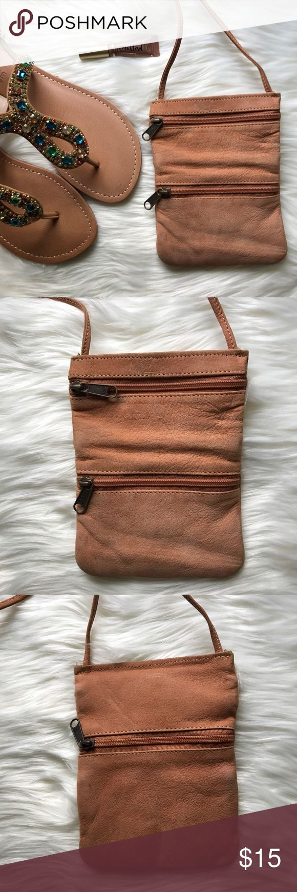 💫 SALE 💫 Emily Ann - Leather - Made in India Emily Ann of Boca Raton Brown/Tan Genuine Leather Crossbody Pouch. Vintage bag, two zippers on the front and one on the back. This bag goes has a worm feel to it. Perfect for the summer! Emily Ann Bags Crossbody Bags