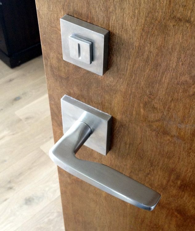 emtek hermes modern passage door lever with square rosette coupled with linnea tper200