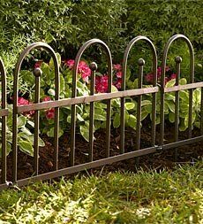 "Scroll Edging by Plow & Hearth. $59.95. Wrought-iron edging is a pretty and practical addition to your garden or flower beds. The easy-locking ring system allows for flexibility around curves and corners. Durable pewter-colored powder-coat finish. 6 sections of 18 x 18"" and 2 sections of 9 x 18"". Import"