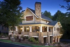 Craftsman Exterior of Home with double-hung window, Trellis, Pathway, Raised beds, Deck Railing