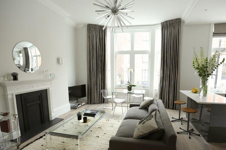 56 Welbeck Street | One Bedroom Apartment Living Room | Sputnik Light | Berber Rug | Vintage Lucite Coffee Table