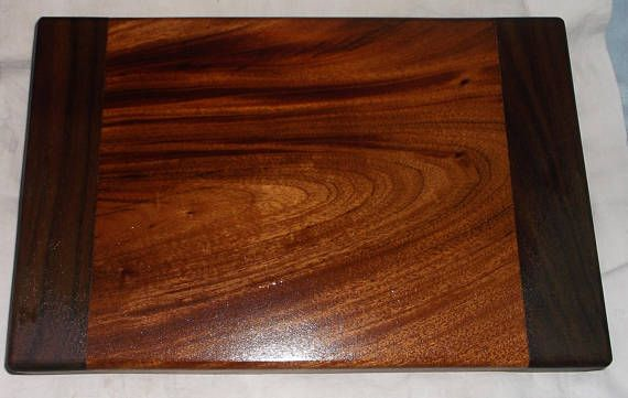 For sale is this Handcrafted Walnut and Maple Butcher Block Style Cutting Board. This comes seasoned with Pure Mineral Oil which is food safe. This item measures 12 7/8 long by 8 3/8 wide by 1 3/4 thick. Great for RVs and small kitchens. Will ship worldwide. Please email me and I