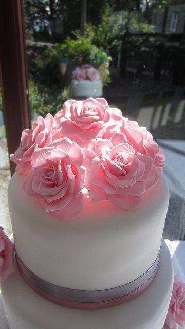 Sugar roses on top tier of wedding cake