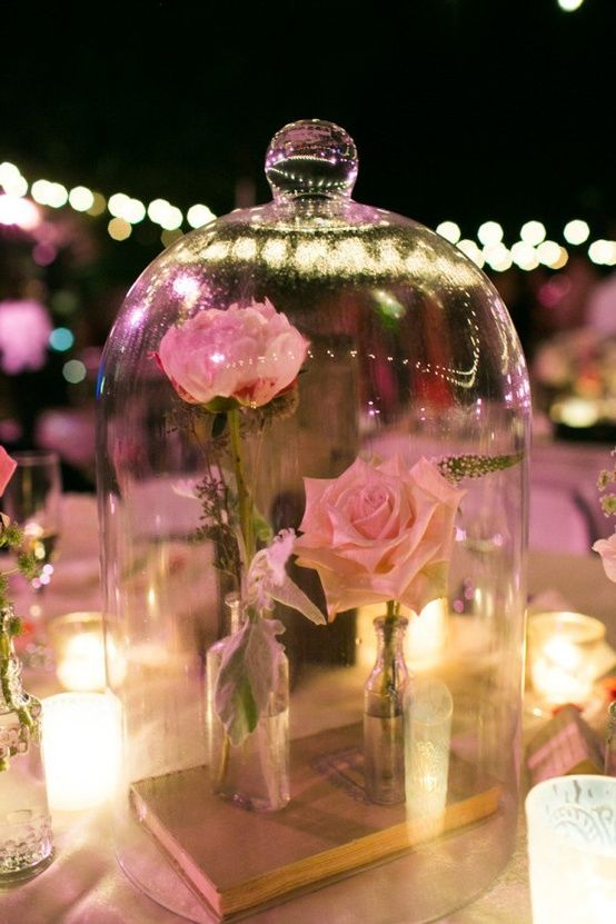 Beauty and the Beast centerpieces. i love this so much more than using a normal vase. This will be my wedding center piece, I may use red roses though
