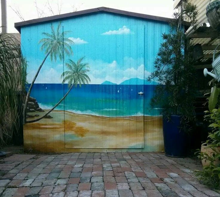 Outdoor Garden shed painted with beach scenery.  Shed makeovers.  Outdoor hand painted mural.