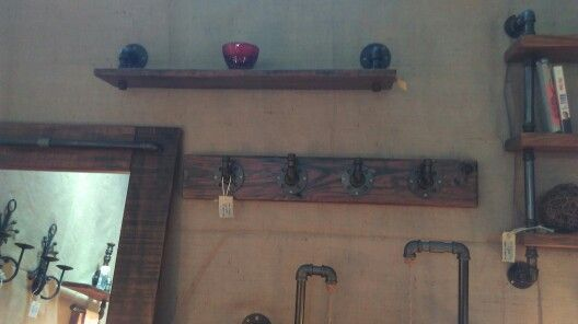 Clothing hooks and shelving and lights that we make on display at our stall.