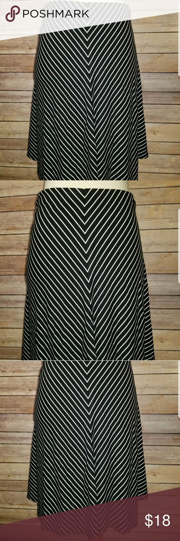 "Ann Taylor A Line Skirt Sp Petites Ann Taylor Skirt  Black and White Striped Jersey Knit Skirt  A Line Fit  Size Sp  Measurements  Waist 14""  Length 19""  94% Rayon, 6% Spandex  Machine Wash Cold, Gentle Cycle, Dry Flat  In Good Condition  From a Smoke Free Home Ann Taylor Skirts A-Line or Full"