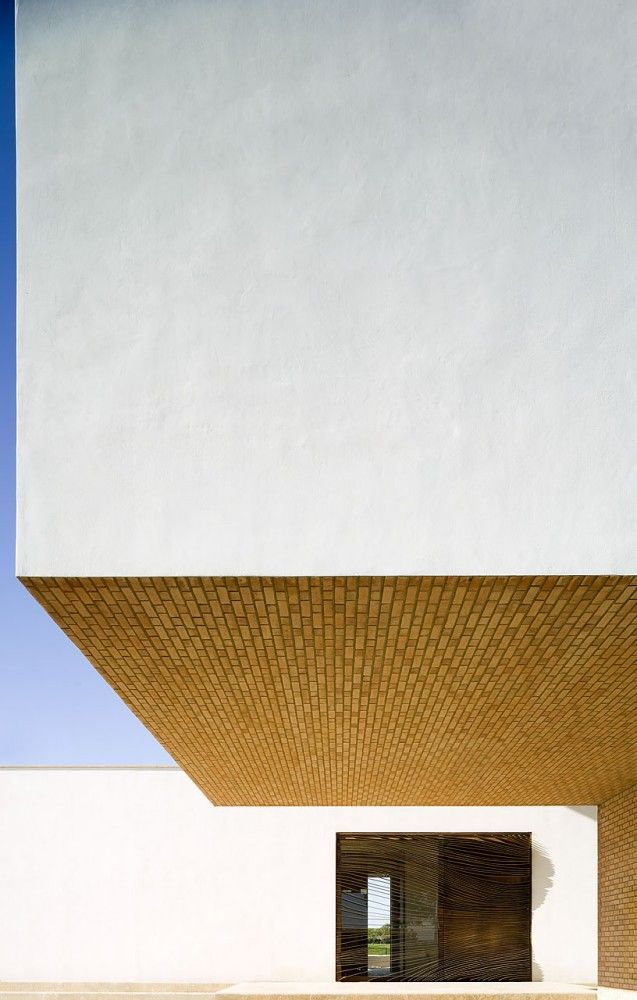 The impact of massed forms, simplicity and repetition. The architect is Salvador Cejudo, the building is called Brick and White and it is in Seville, Spain.