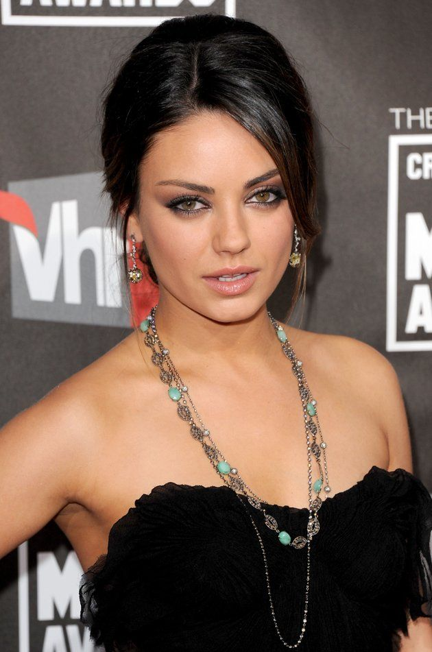 """Co-star in the """"Black Swan"""" movie by Darren Aronofsky, Mila Kunis is also famous for her stunning and a bit exotic beauty. Ukrainian-born actress rocks up the red carpet with her extremely hot looks, her trademark smoky eyes make-up and shiny long locks."""
