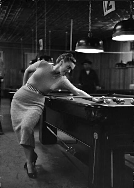 Young woman playing pool, Hoboken, New Jersey, 1951.  Photo: Dan Weimer