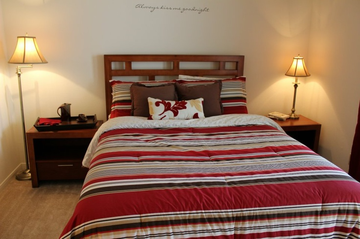 Red And Brown Bedroom Setup At Gentry Square Apartments