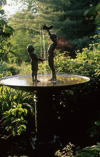 A water feature is a great addition to any garden. This fountain is by Utah artist Gary Prince. - Traditional Home ®