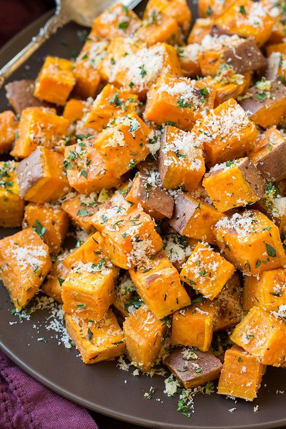 Garlic-Herb Roasted Sweet Potatoes with Parmesan  - Delish.com