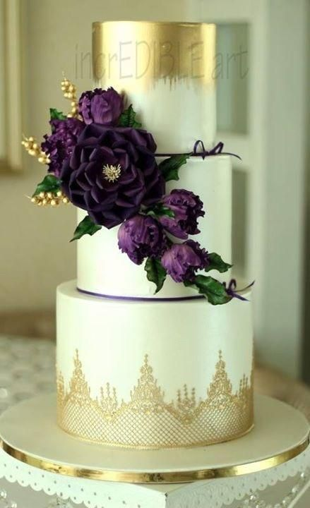 Gold lace, light green cake and deep purple flowers make for a SHOWSTOPPING wedding cake!