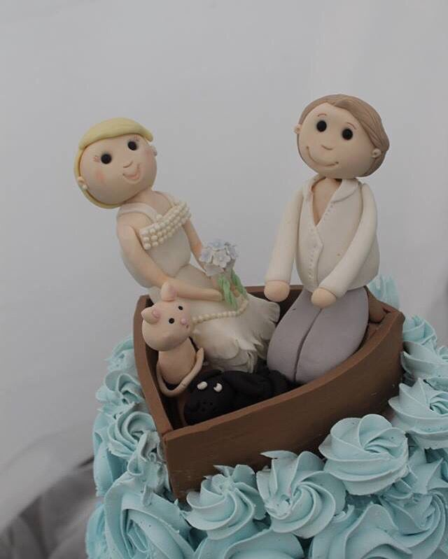 Bride, groom plus the cat and dog for a wedding cake topper