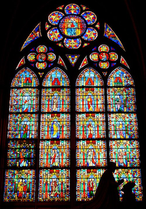 notre dame, paris. When I was little, my mom worked with a 'wives of architects' group to raise funds to refurbish one of the many stained glass windows here.  I got to see it as an adult.  WOW