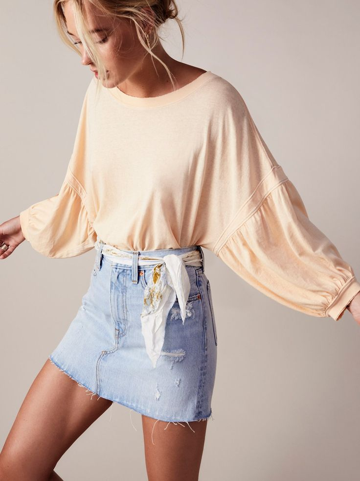We The Free Sugar Rush Tee | Ultra comfy cotton tee with a relaxed fit featuring a pretty puffed shape at the sleeves. *Distressed trims * Semi-sheer
