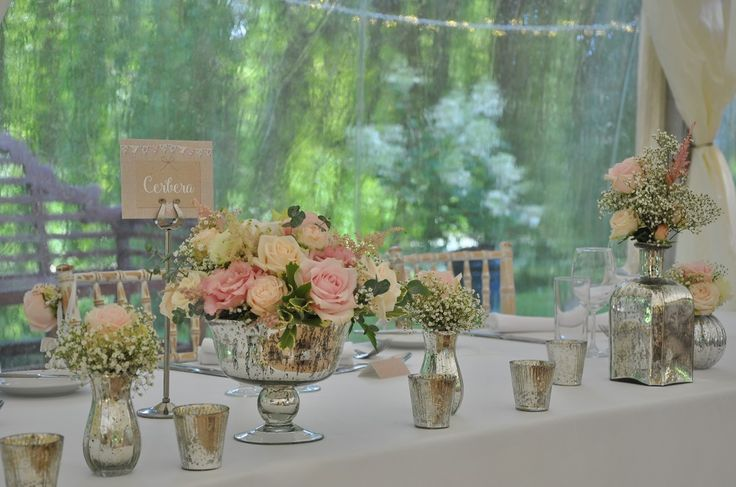 Small silver vases used for top table flowers