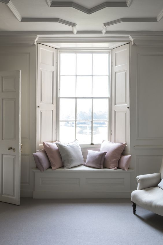 Interesting to see painted panels with window seat....so light, so pretty!
