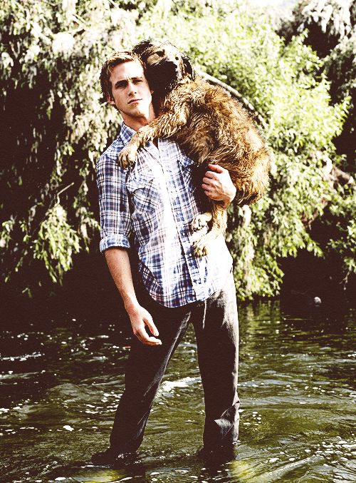 Ryan Gosling carrying his dog through a stream. Love him