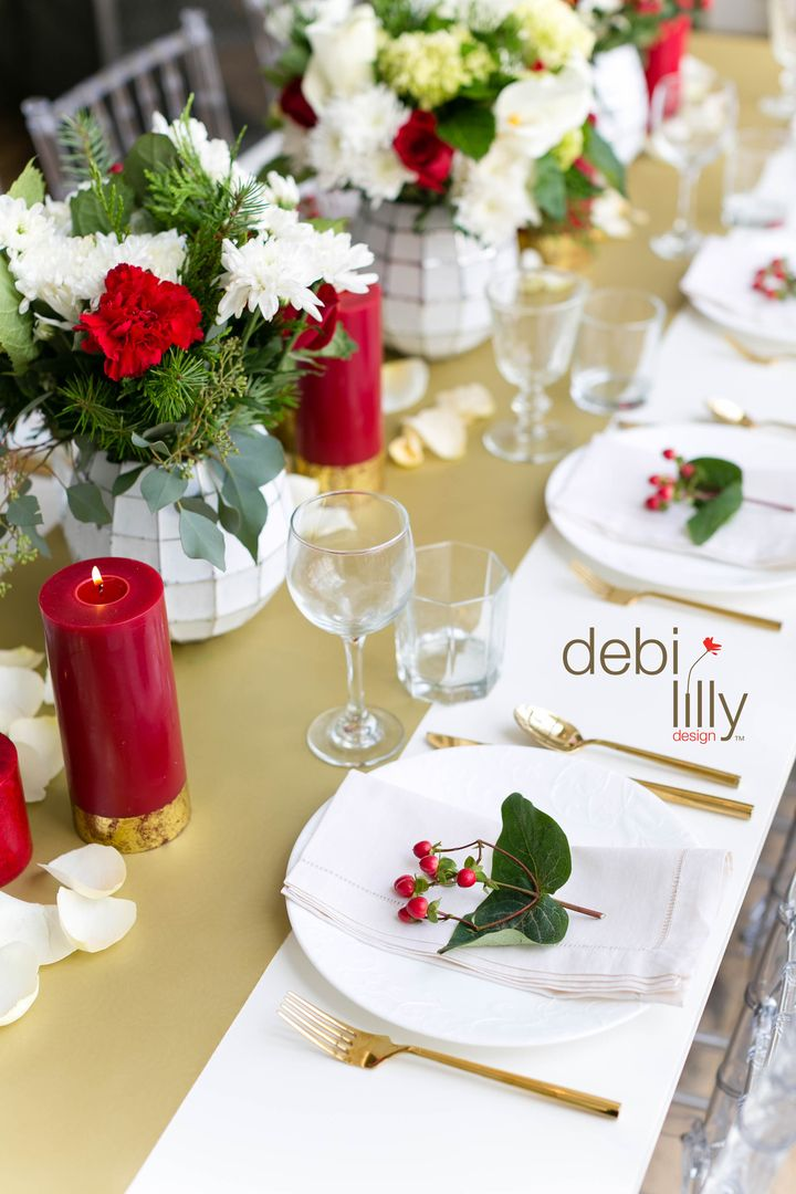 These debi lilly design™ cranberry spice candles will add a festive look and smell to any dinner party. We love the gold details!