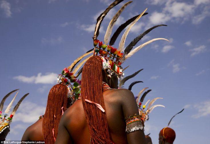 Looking good: Samburu tribesmen show off their impressively large beaded collars and ostri...