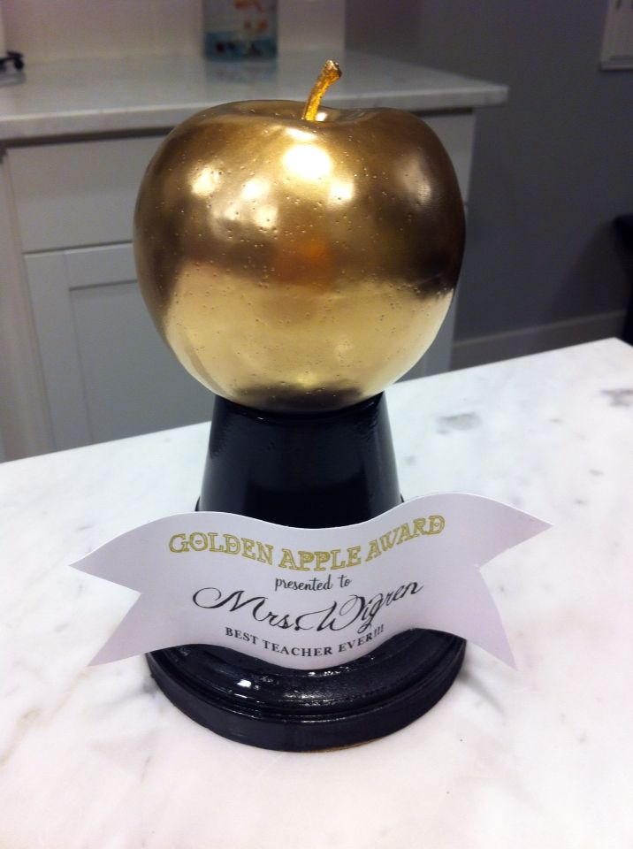 Golden Apple Award for Best Teacher Ever!! I simply spray painted a fake apple metallic gold. Glued small terra cotta pot to a round piece of wood purchased at Joann's.  And spray painted them both black. I glued the apple to the top and printed out a label!! Easy peasy!!! Great end of the year gift...it will accompany a larger gift!!