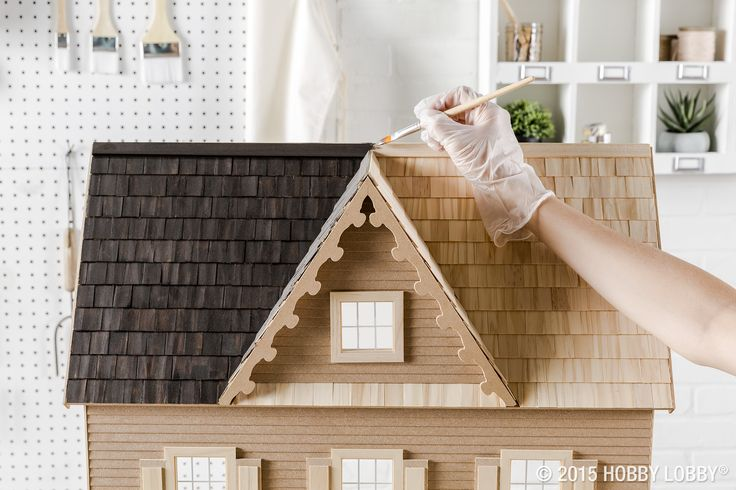When re-doing a dollhouse roof, it's easiest to start at the top and work your way down, so the shingles will be the first order of business. Another advantage to starting with the shingles is that if any stain drips onto other parts of the house, you'll just paint over them later.