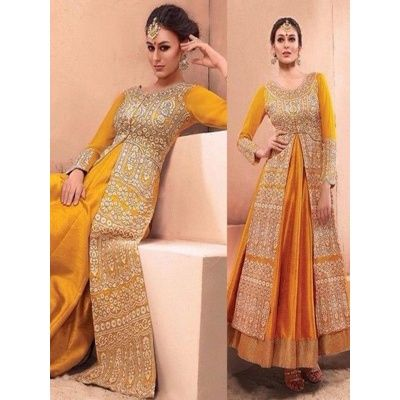 Heavenly Mustard Raw Silk Anarkali Suit with Mustard Color Santoon Bottom.It contained the work of Zari,resham embroidery with Lace border.The Anarkali Suit Which can be customzied up to bust size 42