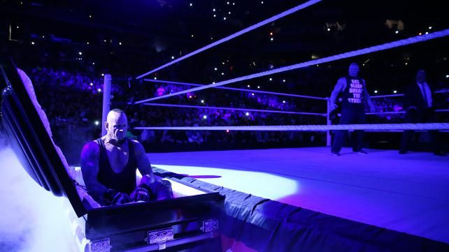 The Undertaker rises from a coffin to attack Brock Lesnar: photos | WWE.com
