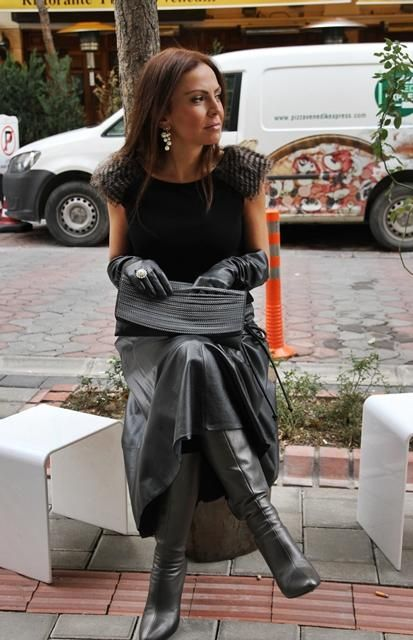 Long leather skirt, tall boots, long gloves