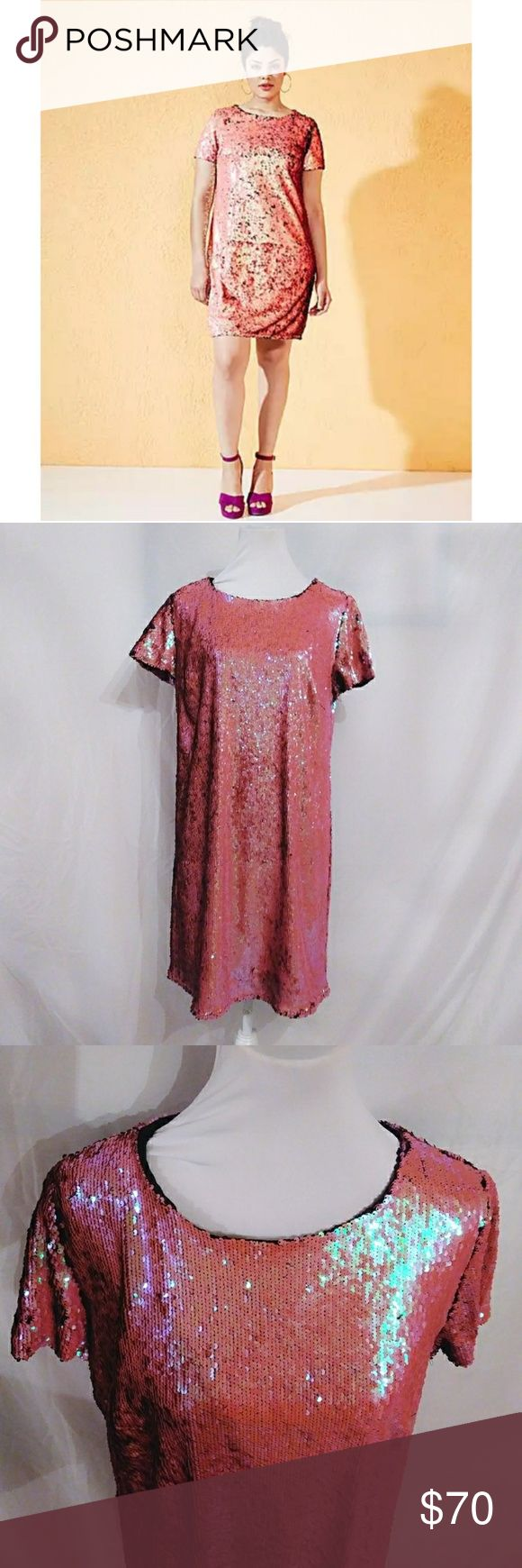 "Coral Rainbow Sequin Shift Dress Coral Rainbow Sequin Shift Dress size - 12. A fabulous all over two-tone sequin shift dress that is fully lined, stretch fabric with short sleeves. Very sparkly with the underside of the sequins being black, move the sequins in a different direction to add effect! Measures 35"" in length, polyester and polyester lining. I took photos in different lighting so you could see the true beauty of these sequins. It will be shipped in the box it arrived in, with the…"