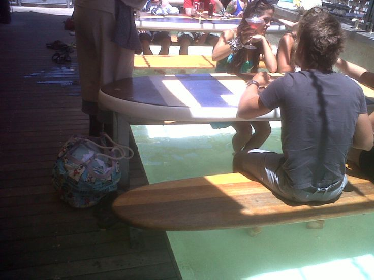 Moya, Eden on the Bay, Cape Town.....where you can sit on a surf board with your feet in a pool overlooking the most beautiful ocean...while having lunch!!!!