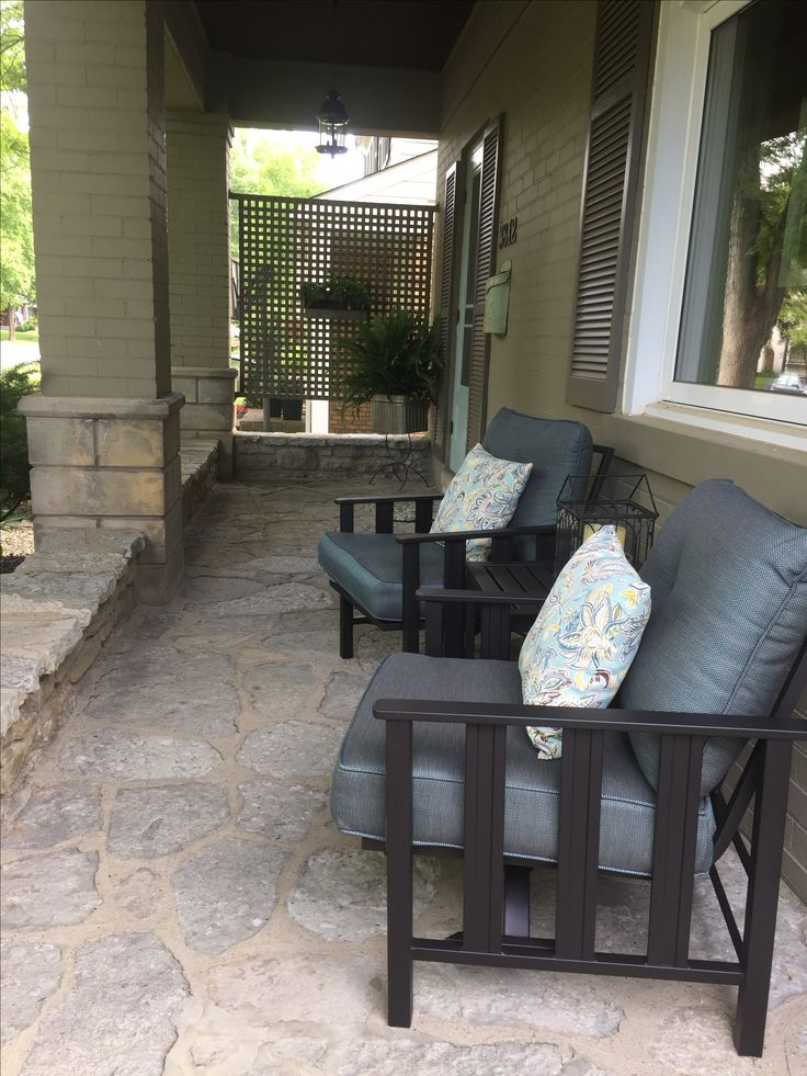 Our summertime porch refresh is complete. New AWESOME chairs with a little bounce from At Home's Astoria Collection, rustic planters and new Parisian farmhouse mailbox.