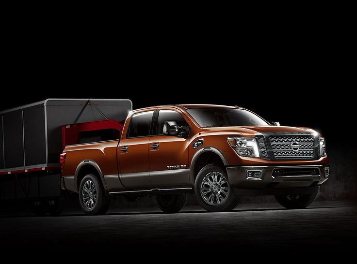 All New Nissan Titan XD 2016 towing capacity. Side view with attached trailer